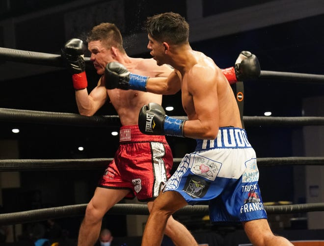 Jose 'Joey' Perez, right, lands a punch against Jose Edgardo Garcia during their featherweight bout in Los Angeles on Wednesday.