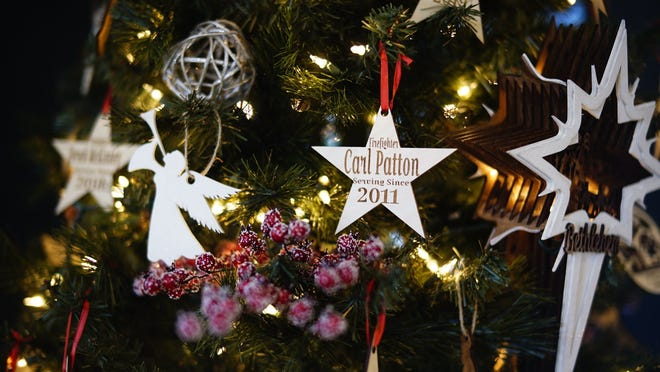Black Mountain Fire Department's tree features carved wooden stars inscribed with the names of firefighters and a 3D manger scene.