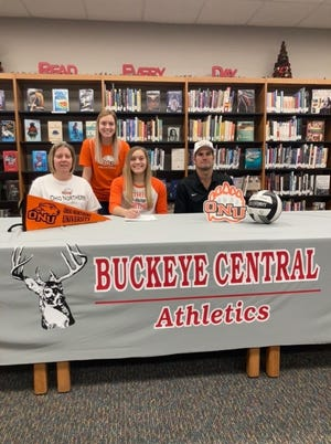 Buckeye Central's Kendra Ackerman signs her letter of intent to continue her volleyball career at Ohio Northern University. Her mother Nancy and father Aaron sit beside her, sister Addie is standing.