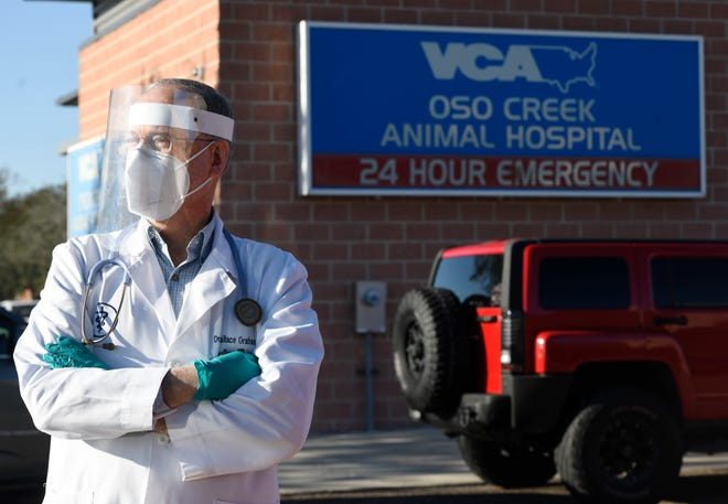 """Dr. Wallace Graham stands in front of VCA Oso Creek Animal Hospital and Emergency Center for Best Veterinarian, Thursday, Dec. 17, 2020. """"I love medicine and enjoy the patients and have a fabulous team,"""" Graham says."""