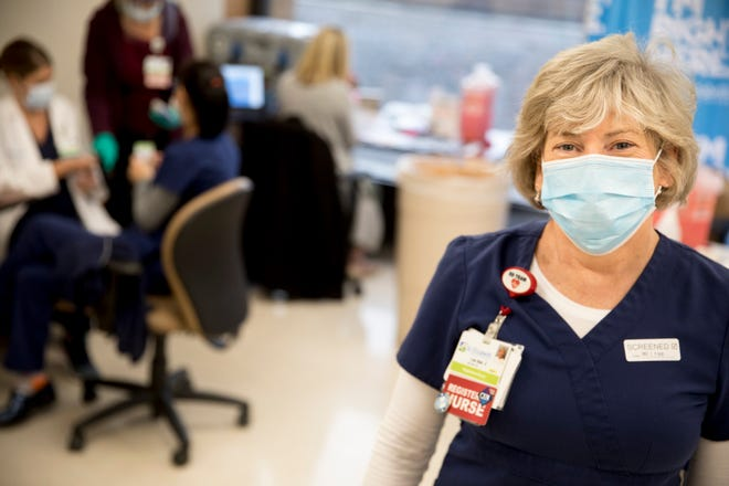 Lee Ann Ernst, St. Elizabeth nurse and coordinator of the Infectious Disease Response Team, stands in a conference room where COVID-19 vaccinations are being administered to frontline workers at St. Elizabeth Hospital in Fort Thomas, Kentucky on Thursday, Dec. 17, 2020.