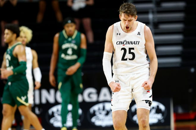 Cincinnati Bearcats forward Rapolas Ivanauskas (25) reacts after causing a turnover during the second half of an NCAA men's college basketball game against the South Florida Bulls, Wednesday, Dec. 16, 2020, at Fifth Third Arena in Cincinnati. South Florida won, 74-71.