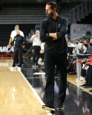 """""""First time in 25 years I went to a pregame meal with no food,"""" UC head coach John Brannen said of the mix-up prior to the game. Nevertheless, Brannen's Bearcats snapped a five-game losing streak with a 76-69 victory over SMU."""