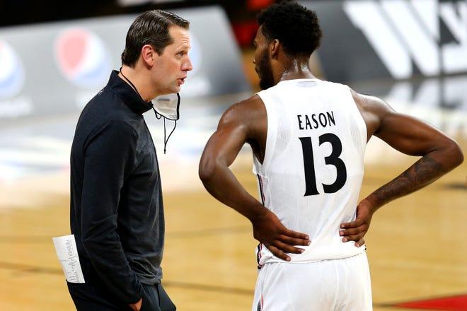 Cincinnati Bearcats head coach John Brannen talks with Cincinnati Bearcats forward Tari Eason (13) during the first half of an NCAA men's college basketball game, Wednesday, Dec. 16, 2020, at Fifth Third Arena in Cincinnati.