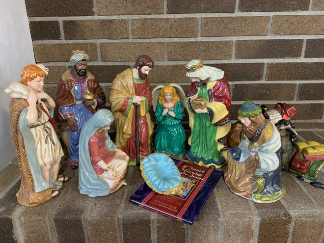 """A manger scene missing baby Jesus and the  book """"If You're Missing Baby Jesus"""" by Jean Gietzen from the household of columnist Emily Marrison."""