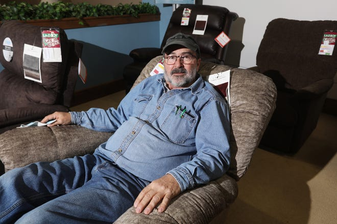 Despite retiring, Keith Wilson still helps out at Wilson Carpet and Furniture Sales in Coshocton.