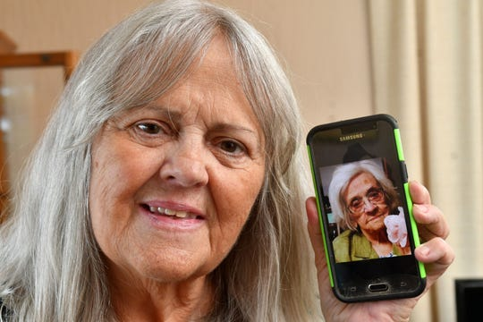 "Sally Munson, of Cordova, shows a cellphone photo of her mother,  Eleanor Moody Pettit, 99, who died recently of COVID-19. Eleanor's glass was ""always half full,"" Munson said."