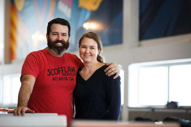 Kinship Brewing owner Zach Dobeck and his wife Ann poses for a photo at the brewery on Thursday, Dec. 17, 2020, in Waukee, IA.