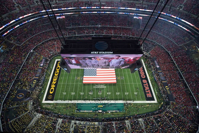 General view of AT&T Stadium in Arlington, Texas, as military members are displayed on the videoboard during the national anthem before the 2015 CFP National Championship Game between the Ohio State Buckeyes and the Oregon Ducks at AT&T Stadium.