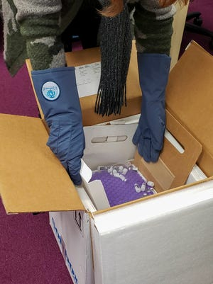 The COVID-19 vaccine from Pfizer is being unpacked Dec. 17, 2020 by the Oakland County Health Division.