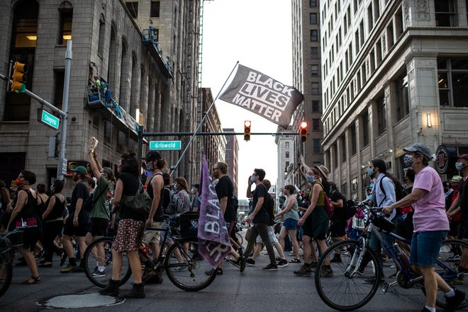Protester march on Griswold Street in Detroit, Wednesday, August 26, 2020.