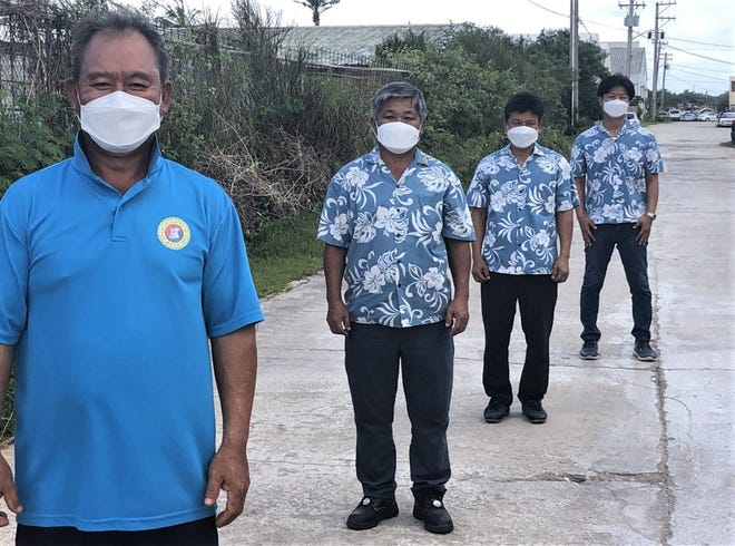 The Korean Association of Guam will donate 2,000 sets of hand sanitizer and masks to the people of Guam at 9 a.m. Dec. 23 at Ypao Beach Park. Pictured from left are Jae Moon Park, association president, Jung Min Seo and Sung Chun Lim, vice presidents and Woo Cho, director.