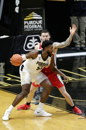 Purdue forward Trevion Williams (50) is guarded by Ohio State  Kyle Young (25) during the second half of an NCAA men's basketball game, Wednesday, Dec. 16, 2020 at Mackey Arena in West Lafayette.