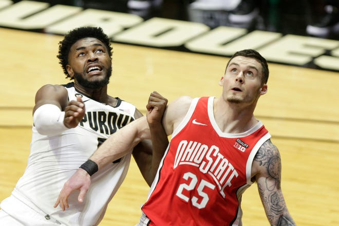 Ohio State Kyle Young (25) boxes out Purdue forward Trevion Williams (50) during the first half of an NCAA men's basketball game, Wednesday, Dec. 16, 2020 at Mackey Arena in West Lafayette.