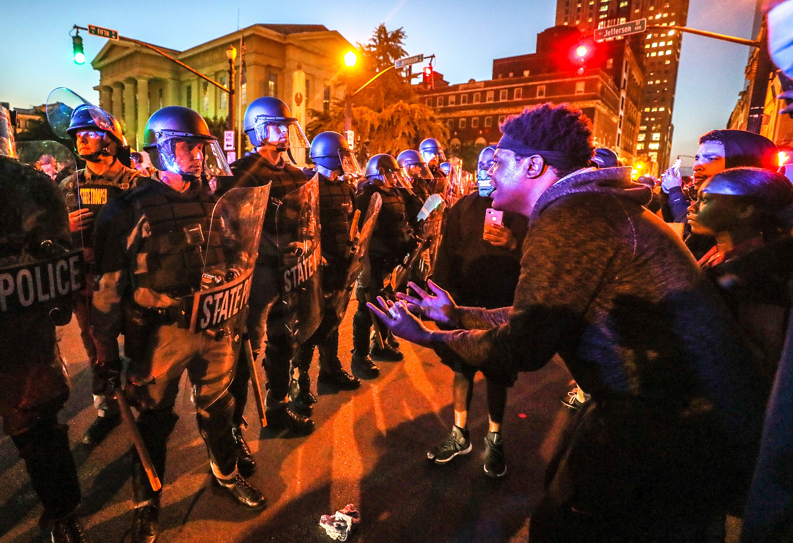 Protesters square off against the Kentucky State Police on 5th Street on Friday, May 29, 2020.
