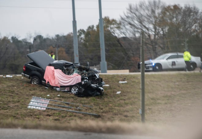 Alabama State Troopers investigate a fatal crash on Cobbs Ford Road near the northbound exit ramp of I-65 in Millbrook, Ala., on Thursday, Dec. 17, 2020.