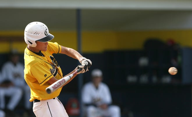 FILE -- Cowan's Aaron Wells hits the ball during a game against Delta on Wednesday, May 19, 2010.