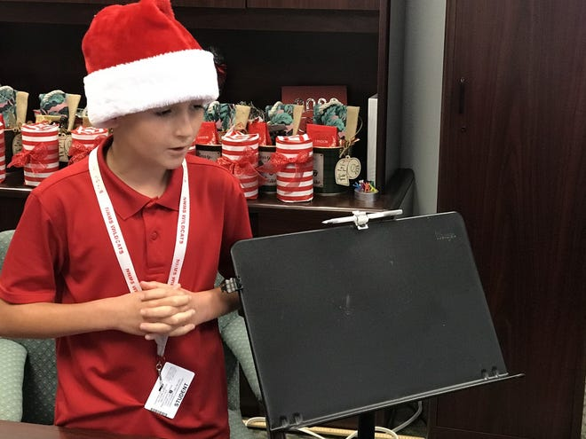 Mason Lyba presents his product, the bow quiver, on a WebEx call on Dec. 17.