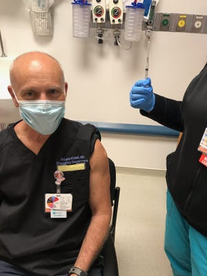 Dr. Douglas Kinkel, Emergency Department Medical Director, received the COVID-19 vaccine at Mimbres Memorial Hospital. Vaccinations and COVID-19 testing are keeping the positivity rate down in Luna County.