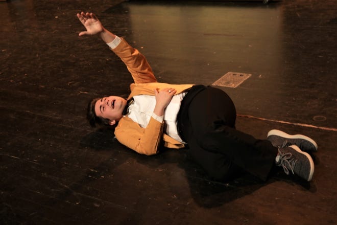 """Actor Nick Drivas rehearses a scene from the Four Corners Musical Theatre Company's production of """"Disaster!"""" in February at the Farmington Civic Center."""