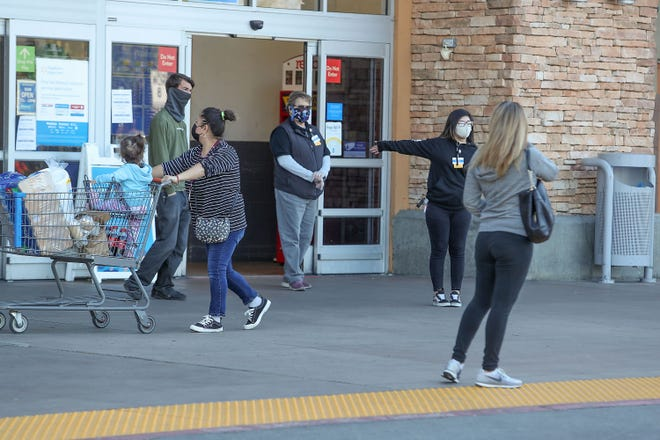 Walmart employees turn away customers after the store closed for cleaning in Palm Springs, December 17, 2020.