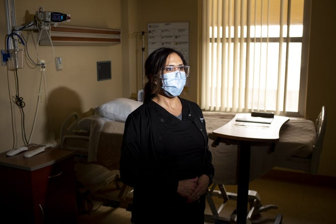 Regina Villa, who manages nurses at Valleywise Health Medical Center in Phoenix, was one of the first Arizona health care workers to receive the COVID-19 vaccine.