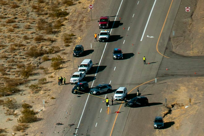 Nevada Highway Patrol investigate the scene of a fatal crash involving multiple bicyclists and a box truck along U.S. Highway 95 southbound near Searchlight, Nev., on Dec. 10, 2020.
