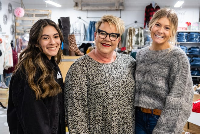 Laura Lyon, owner of Papaya Branch Boutique, center, poses for a photo with employees Maleigha Coronado, left, and Nathalie Robinson, Thursday, Dec. 17 2020, in the downtown business. Papaya Branch Boutique is planning to end its lease and move from its current location on Superior Mall and into the building between 216, 218 and 220 Huron Ave. in downtown Port Huron.