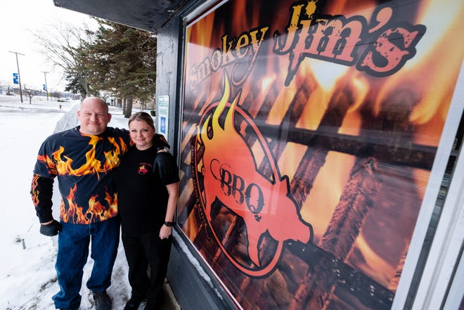 Jim and Jessica Koveck pose for a portrait Thursday, Dec. 17, 2020, in front of Smokey Jim's BBQ in Marysville. The couple are opening the restaurant, which serves carryout and catering, in the former Seasoned Pitmasters building in Marysville.