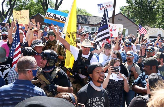 Black Lives Matter protesters and counter protesters gather  in Minden on Aug. 8, 2020.