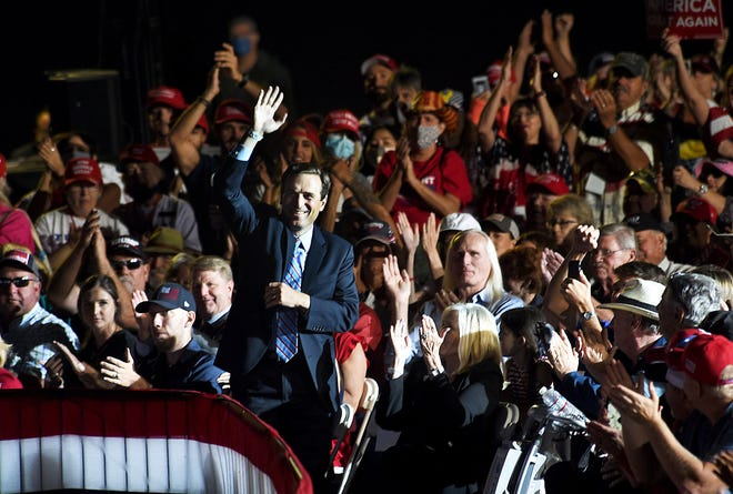 Adam Laxalt, former attorney general of Nevada, is seen waving to President Trump while being recognized during his campaign rally in Minden on Sept. 12, 2020.