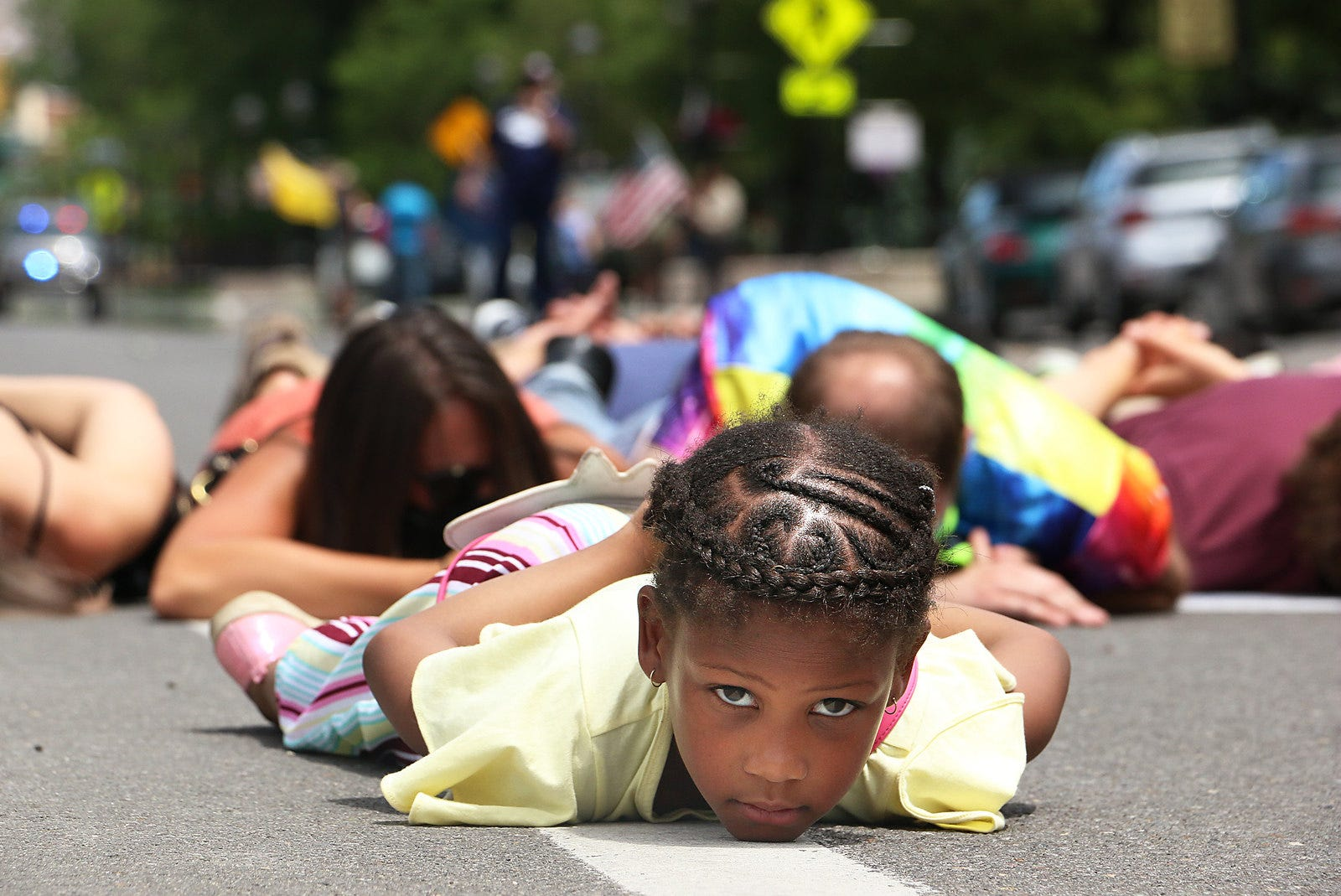 6 year old Destinie (last name withheld by mother) lies on the ground with her fellow protesters for almost 9 minutes during a Black Lives Matter rally in Carson City on June 20, 2020.