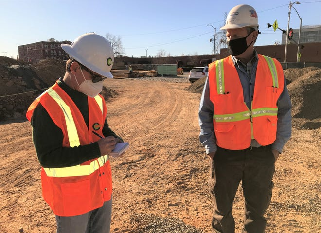 Record Searchlight reporter David Benda, left, interviews Superintendent Bud Shope of Modern Building Inc. on Thursday, Dec. 10, 2020 at the site where a six-story parking structure is being built as part of the Block 7 project in downtown Redding.