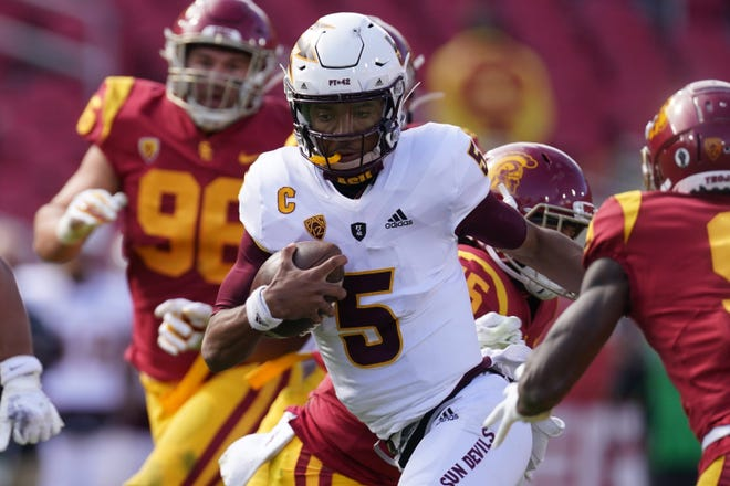 Nov 7, 2020; Los Angeles, California, USA; Arizona State Sun Devils quarterback Jayden Daniels (5) carries the ball in the fourth quarter against the Southern California Trojans at the Los Angeles Memorial Coliseum. USC defeated Arizona State 28-27.  Mandatory Credit: Kirby Lee-USA TODAY Sports