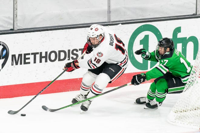 St. Cloud State junior Brendan Bushy skates with the puck against North Dakota Wednesday, Dec. 16, 2020, in Omaha.