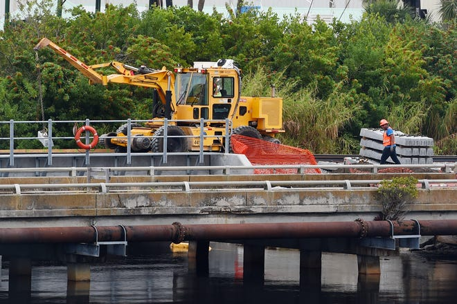 Construction crews continue work on the new Brightline train tracks over Taylor Creek in Fort Pierce on Thursday, Dec. 17, 2020. Though delayed by the COVID pandemic, the company still sees completion by 2022.
