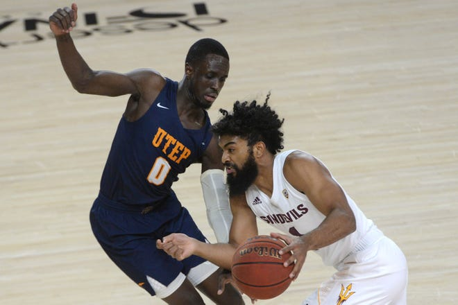 Dec 16, 2020; Tempe, Arizona, USA; Arizona State Sun Devils guard Remy Martin (1) dribbles against UTEP Miners guard Souley Boum (0) during the first half at Desert Financial Arena (Tempe). Mandatory Credit: Joe Camporeale-USA TODAY Sports