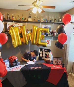 Tulare Western High School senior Mikey Ficher signed on Dec. 16, 2020 to play college football at Davidson College.