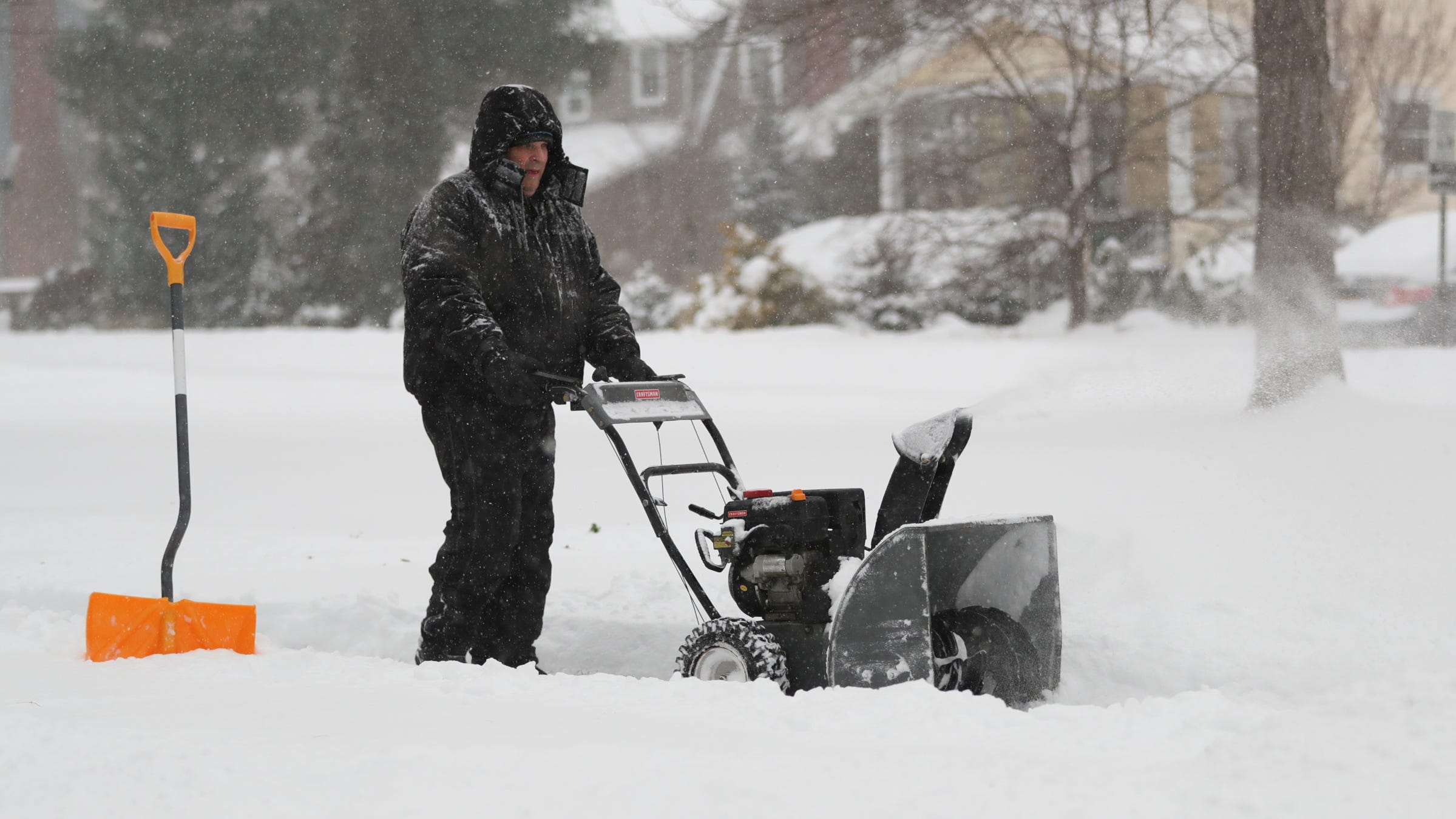Robert Arone uses a snowblower to clear the snow from his driveway in Sloatsburg, New York, on Thursday, Dec. 17, 2020.