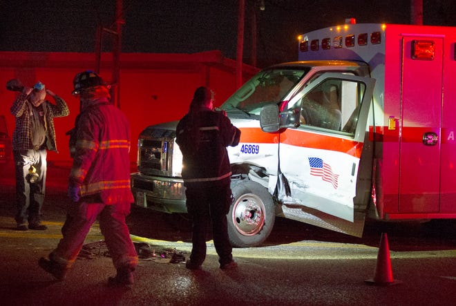 Emergency crews work the scene of an injury accident Wednesday night involving an ambulance.