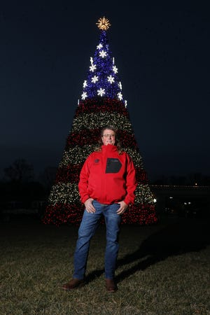 Russ Nelson, owner of Nelson's Seasonal Decor, and his crew set up the giant Christmas tree outside American Pride in Zanesville.