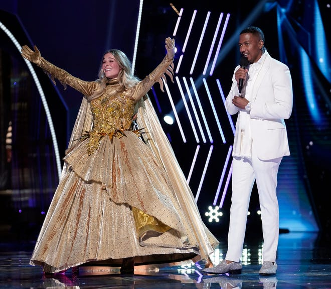 """LeAnn Rimes (with host Nick Cannon) was revealed as the winner Season 4 of """"The Masked Singer,"""" but with no studio audience, Fox faked it with old footage."""