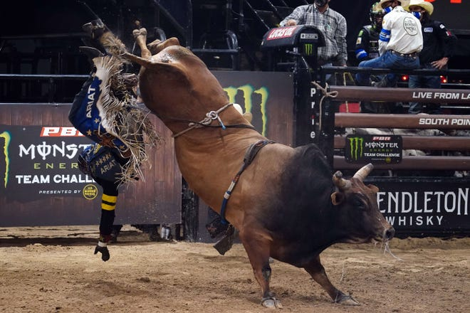 Ezekiel Mitchell rides bull Landslide during the PBR Monster Energy Team Challenge at South Point Arena in June.