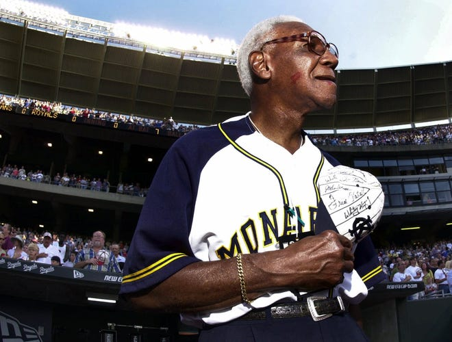 Buck O'Neil appears at Kauffman Stadium, in Kansas City, Mo., in 2001. An exhibit at the Robert L. Taylor Community Complex, in Newtown, honors O'Neil, who grew up in Sarasota before becoming a standout player and manager in the Negro Leagues. The exhibit runs through March 20.