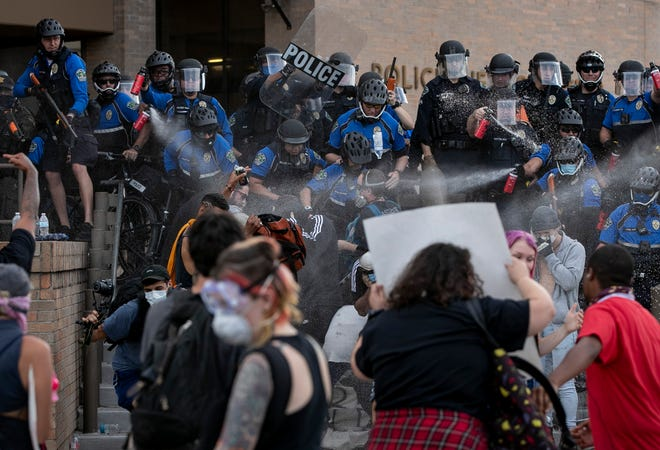 Police and protesters clash outside the Austin Police Department's headquarters during social justice protests on May 30, 2020. The Office of Police Oversight is raising concerns about how the Police Department handled complaints about officers' behavior during last summer's protests.