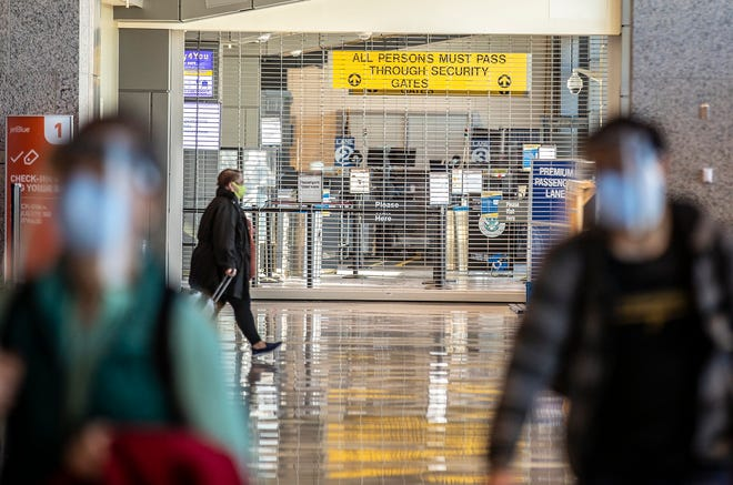 As travelers wait to check in for their flights ahead of the Christmas holiday, TSA Checkpoint 3 at Austin-Bergstrom International Airport is closed because of fewer people traveling.