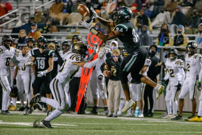 Cedar Park receiver Josh Cameron hauls in a touchdown pass while being covered by Richmond Foster's Coleman Biggs during a Class 5A Division I area-round playoff game Thursday. Cameron had a career-high 187 yards on 10 catches with three touchdowns as the Timberwolves won 51-15.