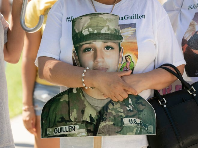 Gloria Guillen, the mother of slain Army soldier Vanessa Guillen, clutches a cutout of her daughter during a rally at Austin's Republic Square Park in September.
