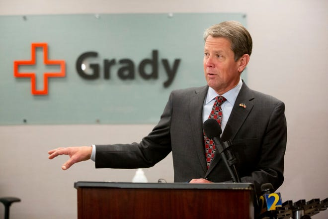 Georgia Gov. Brian Kemp provides updates on COVID-19 in Georgia during a press conference at Grady Hospital, Thursday, Dec. 17, 2020, in Atlanta. (Steve Schaefer/Atlanta Journal-Constitution via AP)
