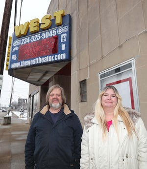Mark Anderson, left, and Bonnie Green stand Friday outside the West Theater Friday in Barberton. Anderson, who owns the building, and Green, who owns the theater and attached restaurant and bar, were among the 20 to 30 small business owners who attended a meeting at Mulligan's Restaurant and Pub in Jackson Township to talk about how they can stand together to oppose state COVID-19 mandates imposed on businesses.